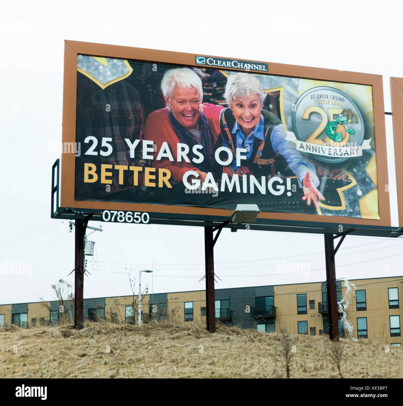 Two older senior woman pictured on an outdoor advertising billboard having fun gambling at the Wisconsin St Croix - Stock Image