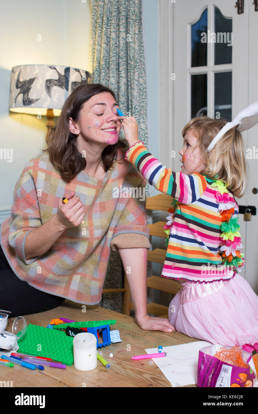 Mother and children practising a 'Yes Day' at home, new masochistic parenting trend, when parents agree - Stock Image