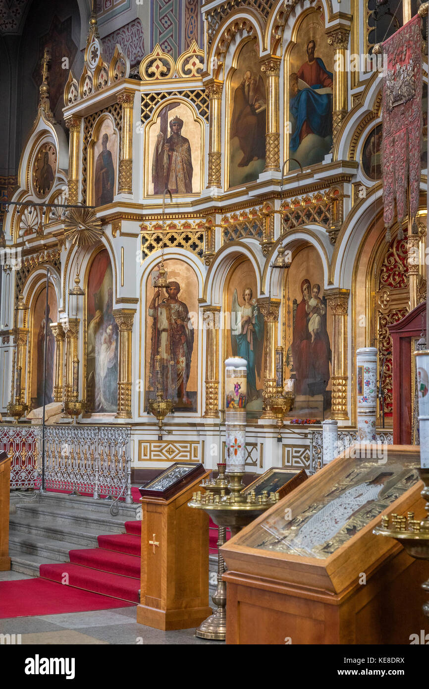The iconostasis in Uspenski Cathedral in the city of Helsinki in Finland. The Cathedral is on a hillside on the - Stock Image