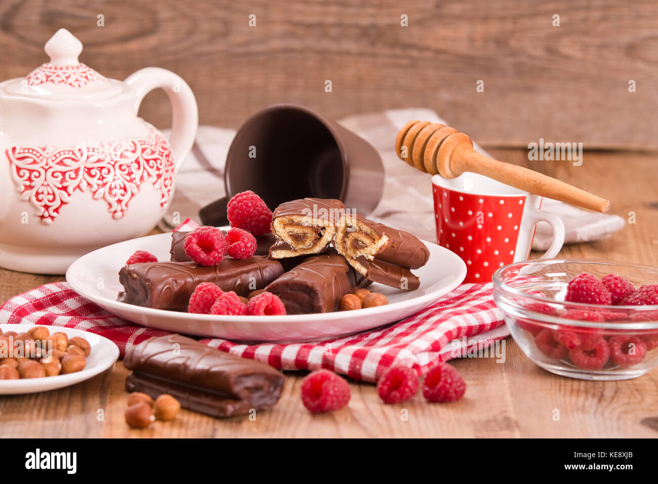 Chocolate rolls with hazelnuts and raspberries. - Stock Image