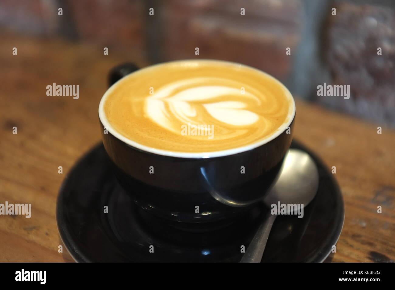 A flat white coffee at Riverhill Coffee Bar, Glasgow, Scotland, United Kingdom. 16 September 2017. - Stock Image
