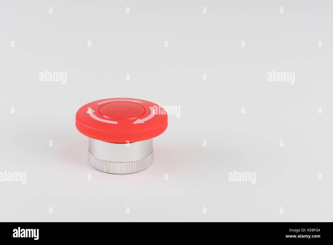 Big red button on light background - metaphor for 'Finger on the Button', possible finger on nuclear button, - Stock Image