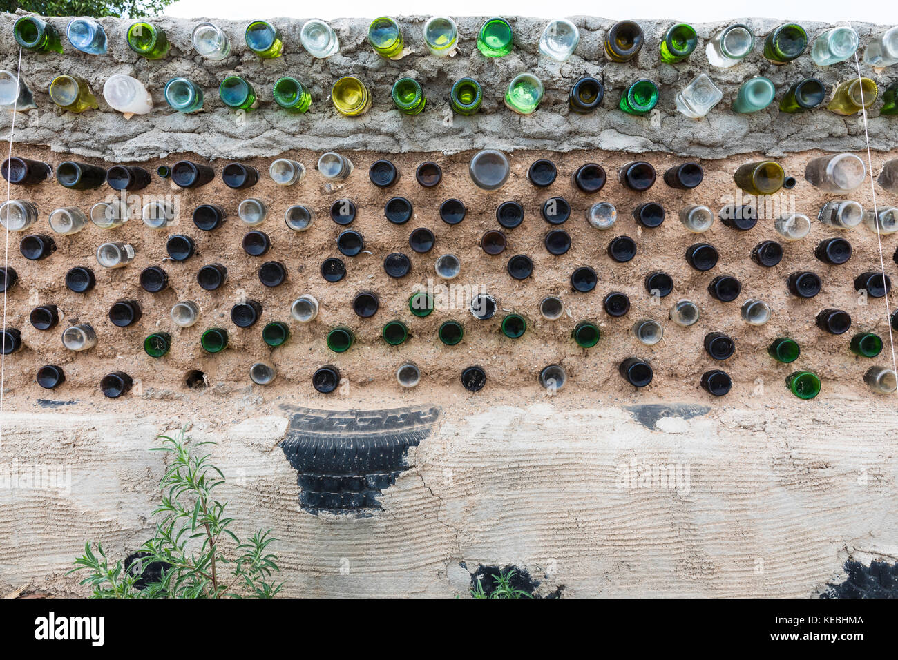 Glass bottles and recycled materials used to construct a wall, Greater World Earthship Community, Near Taos, New - Stock Image