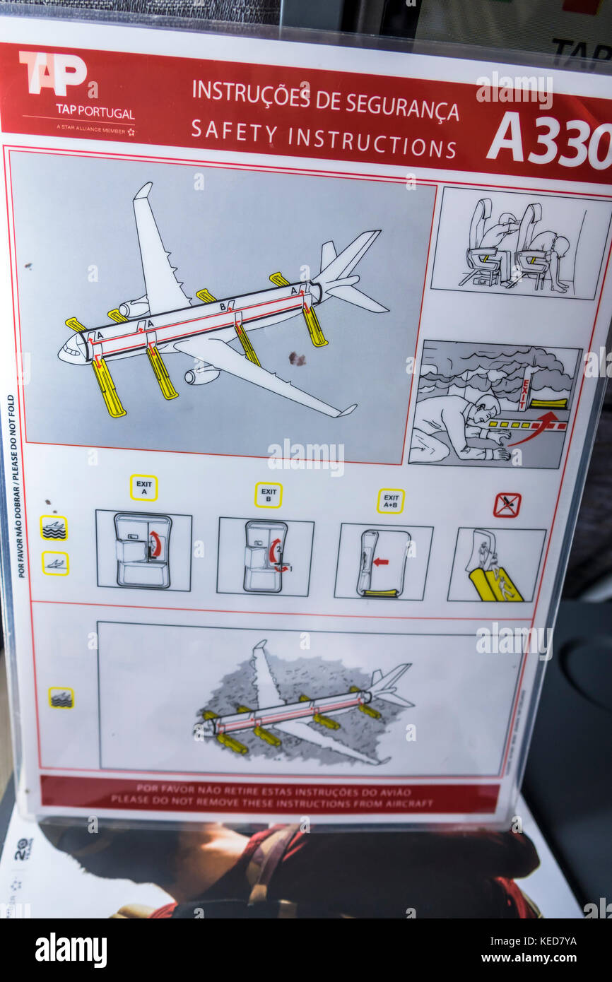 Miami Florida MIA Miami International Airport TAP Air Portugal airline aircraft safety card instructions Airbus - Stock Image