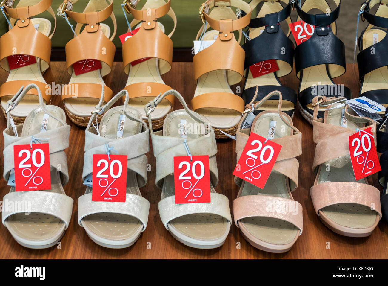 Lisbon Portugal Rossio Square Pedro IV Square shoes store shopping sandals discount display sale shoes - Stock Image