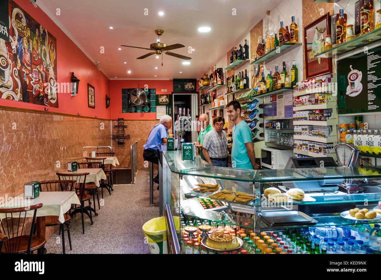 Lisbon Portugal cafe neighborhood restaurant counter man server casual interior - Stock Image