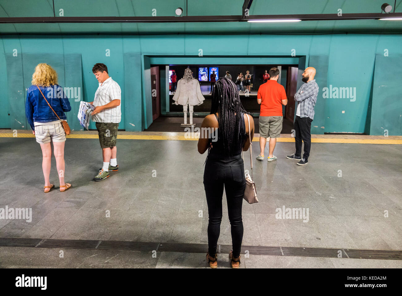 Lisbon Portugal Metro Lisboa public transportation mass transit subway Marques de Pombal station platform man Black - Stock Image