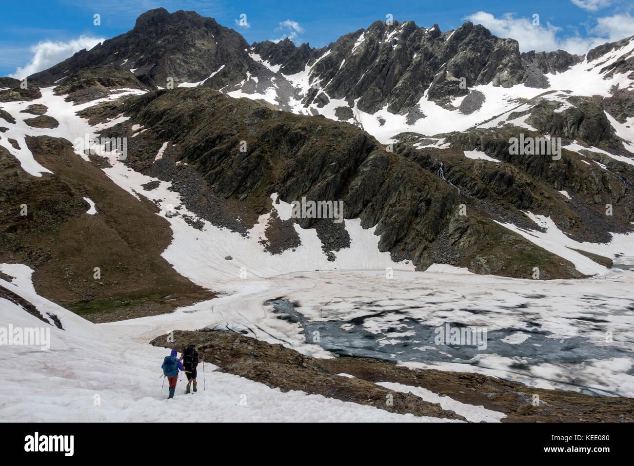 Trekking at the Pyrenees.Baiau lake.Catalunya.Spain - Stock Image