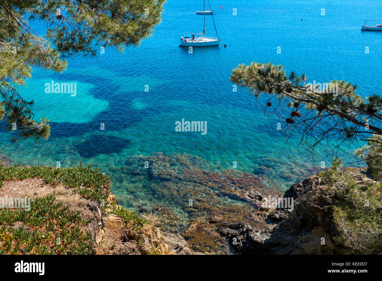 Sailing boat anchored at Cadaques.Gerona Province.Catalunya.Spain - Stock Image