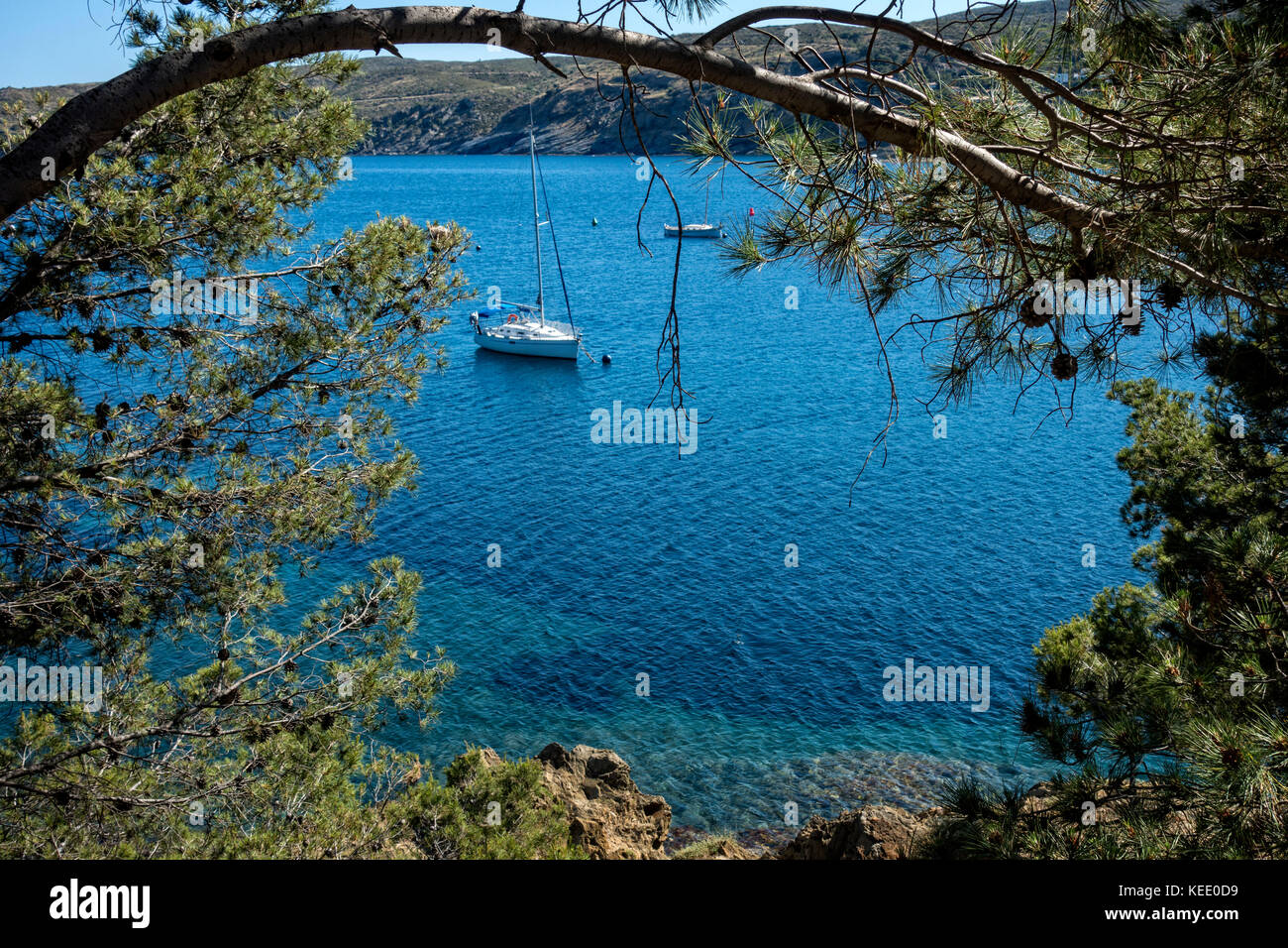 Sailing boat anchored at Cadaques.Catalunya.Spain - Stock Image