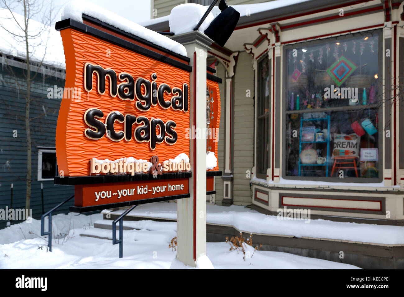 Shop sign for Magical Scraps (fabric and children's clothing store), Breckenridge, Colorado USA - Stock Image