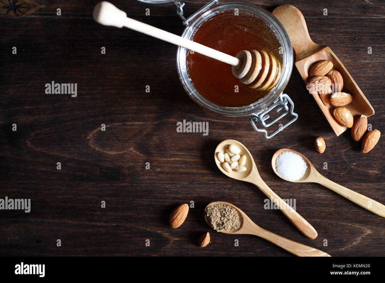Fresh nuts on the table for breakfast with honey - Stock Image