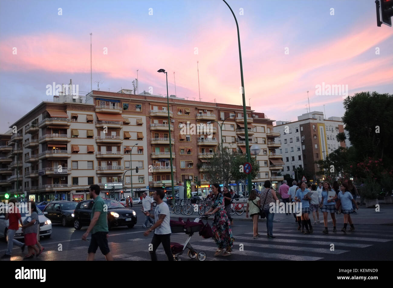 Sunset behind apartments and a crossroad in Seville/Sevilla, Andalucia, Spain, September 2017 - Stock Image