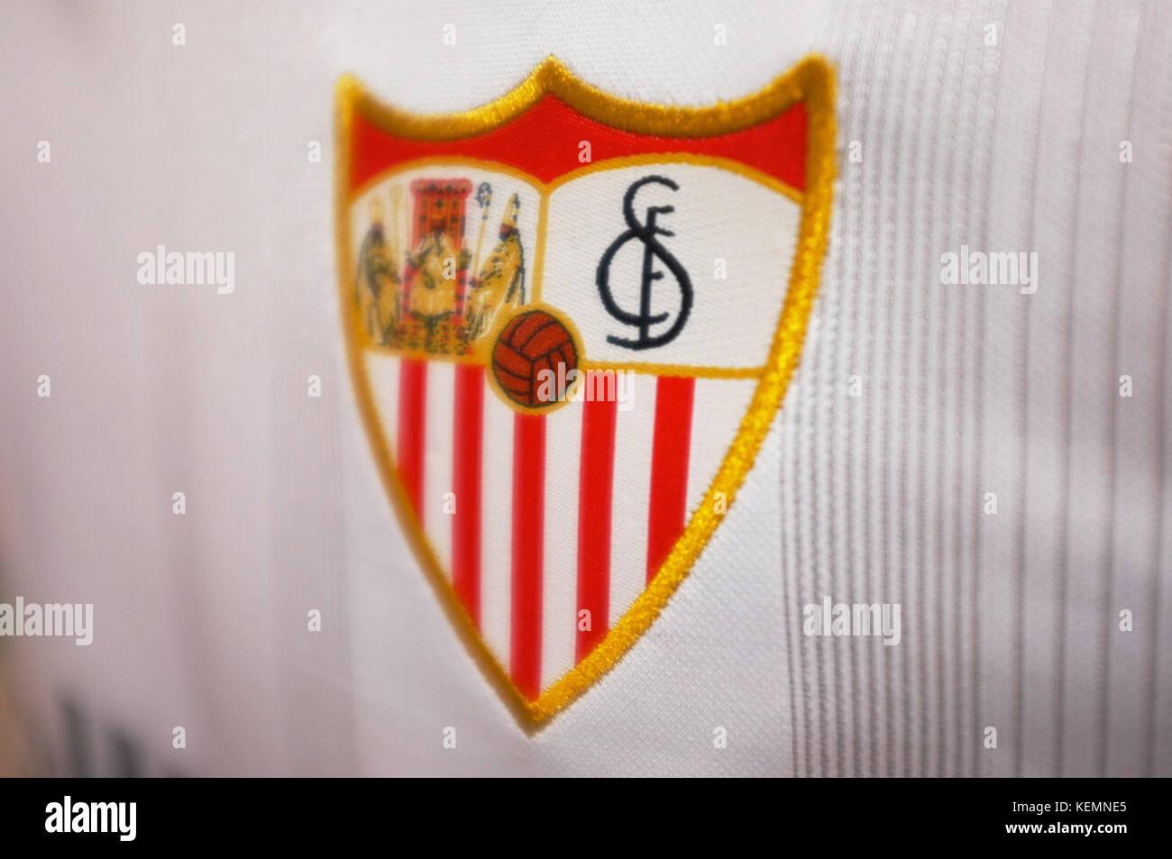 The crest of Sevilla FC on a shirt in the shop at Ramón Sánchez Pizjuán Stadium, Sevilla FC vs Las - Stock Image