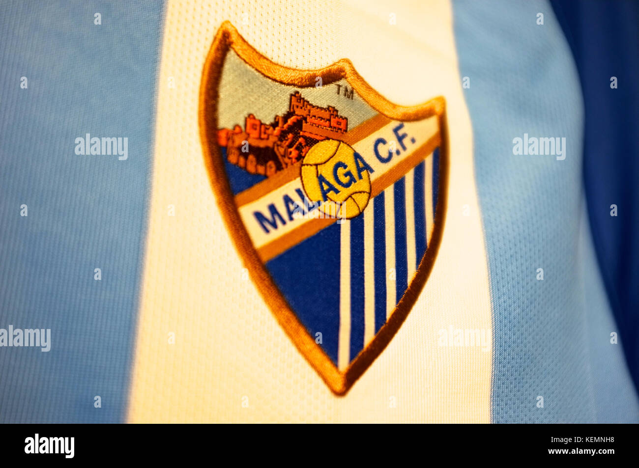 The crest of Malaga CF on a shirt in the club shop at La Rosaleda Stadium, Malaga, Andalucia, Spain, September 2017 - Stock Image
