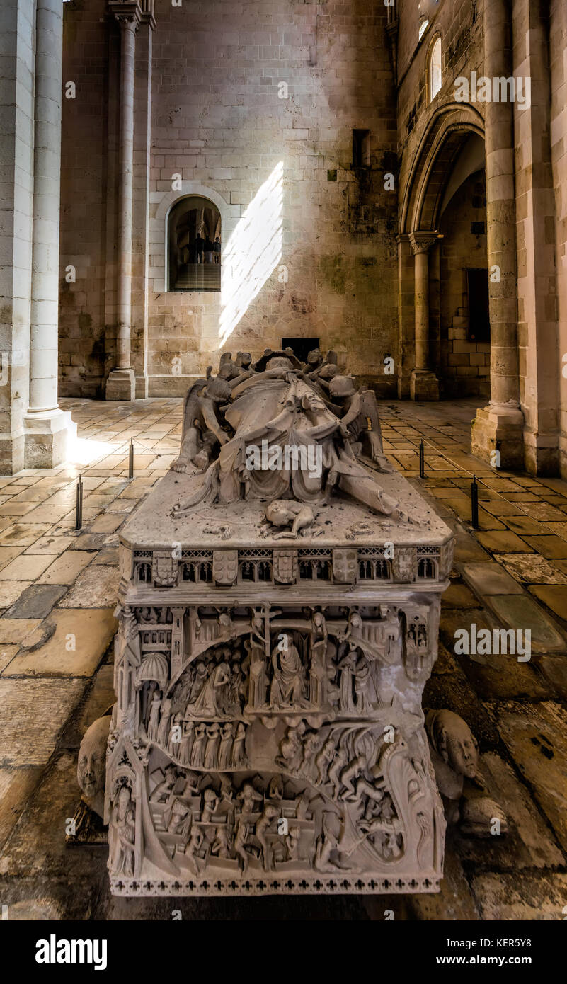 Medieval tomb of Ines de Castro showing Christ presiding over the Last Judgement in the 13th century Alcobaca Monastery - Stock Image