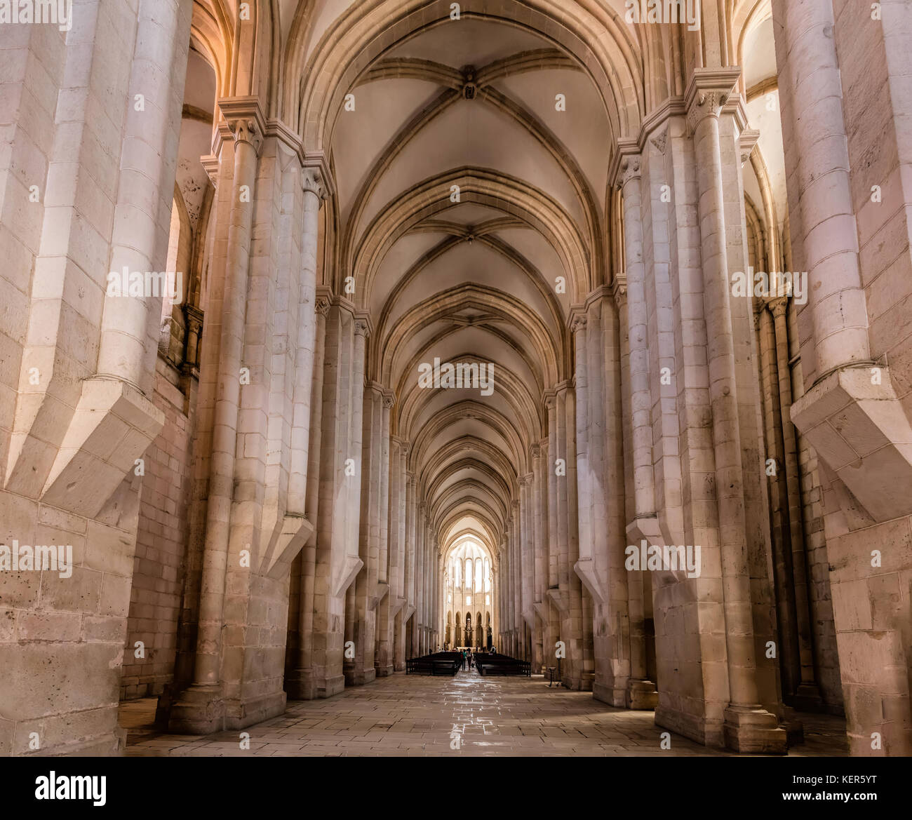 View towards the main chapel and ambulatory of the medieval Alcobaca Monastery, the first truly Gothic building - Stock Image