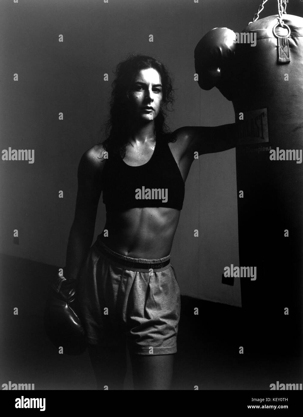 Woman/Girl in boxing gym after workout - Stock Image