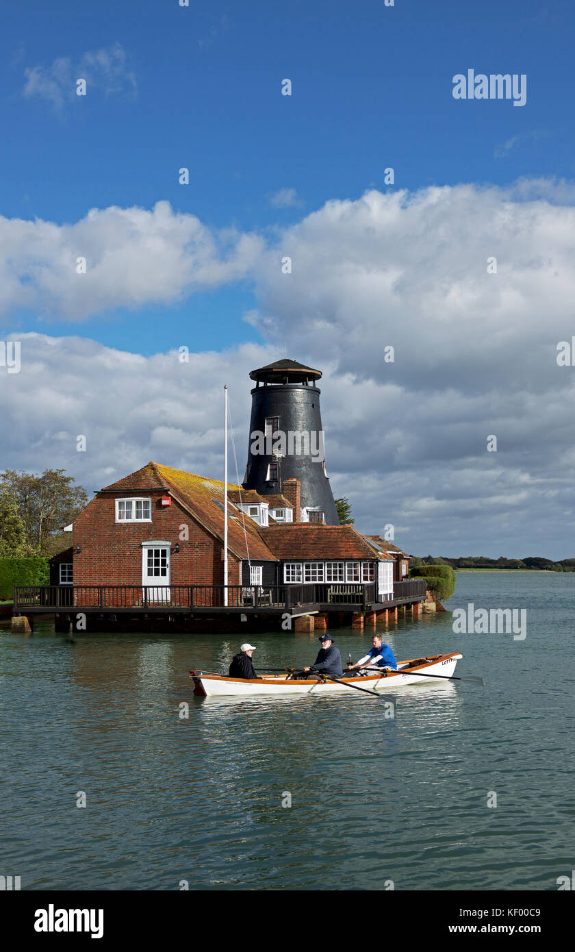 Rowing boat and Langstone Mill, Havant, Hampshire, England UK - Stock Image