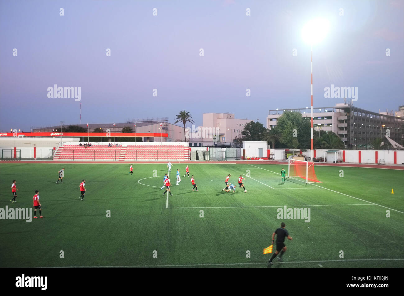 Football match in the evening at Victoria Stadium, Gibraltar, September 2017 - Stock Image