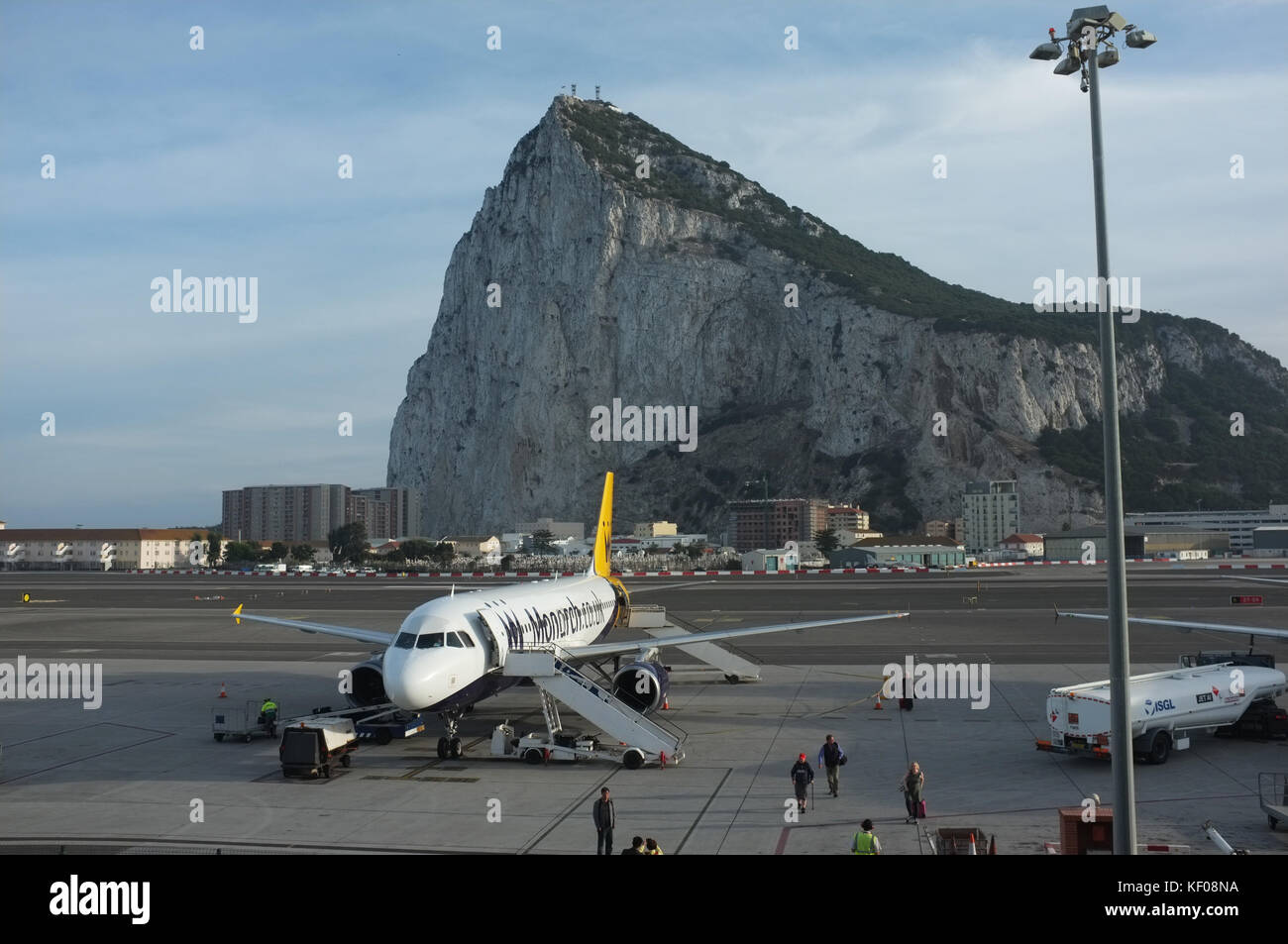 A plane prepares for take off at Gibraltar International Airport, viewed from the departure lounge, Gibraltar, September - Stock Image