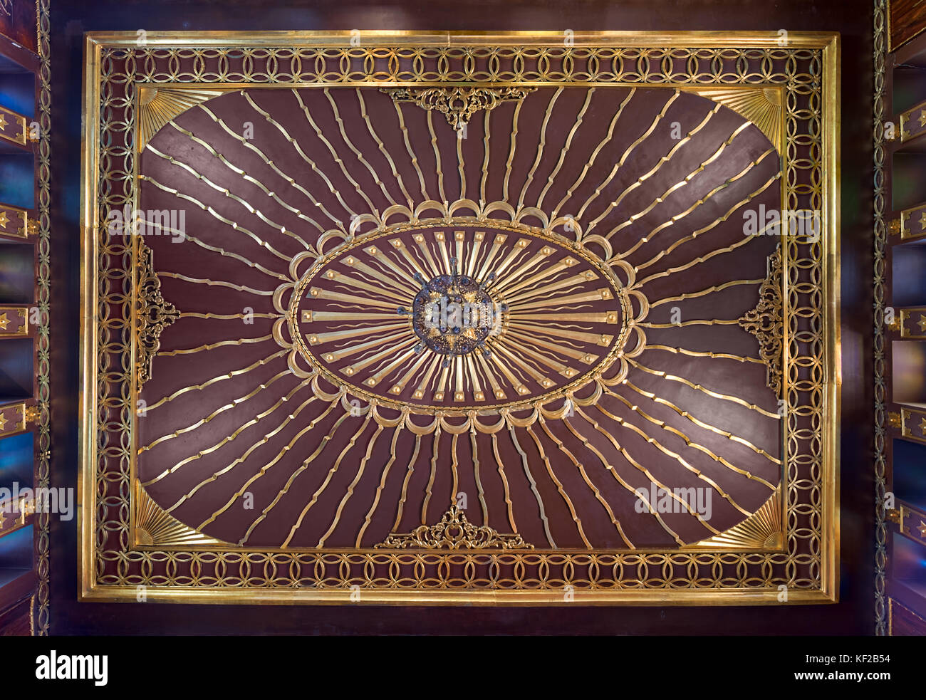 Wooden golden ornate ceiling with design based on sun rays inspired by the old flag of the ottoman empire at the - Stock Image
