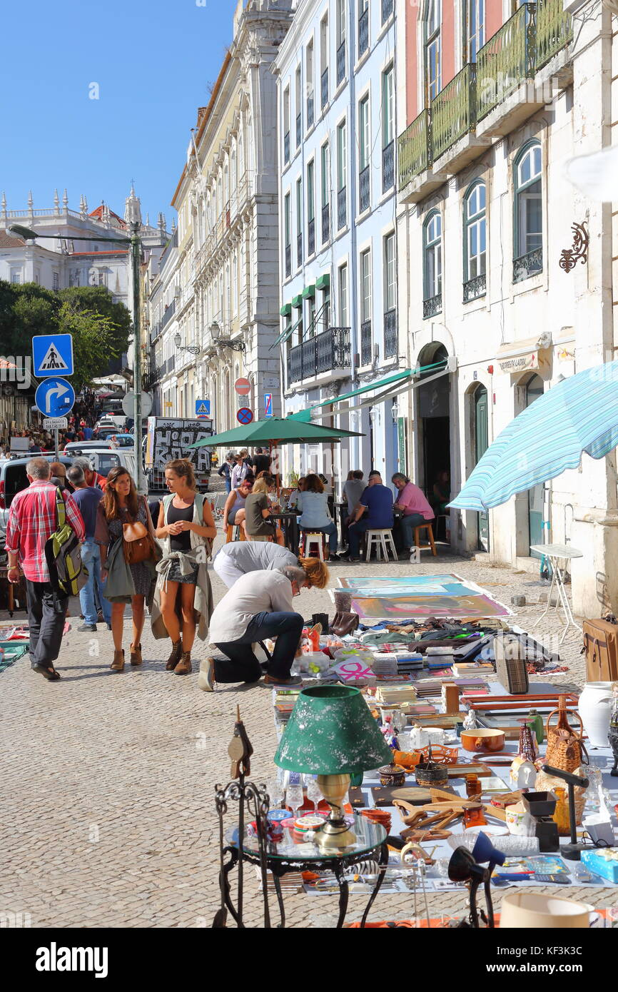 Traders offer all kind of goods at the popular Market of the Thieves in Lisbon Portugal - Stock Image