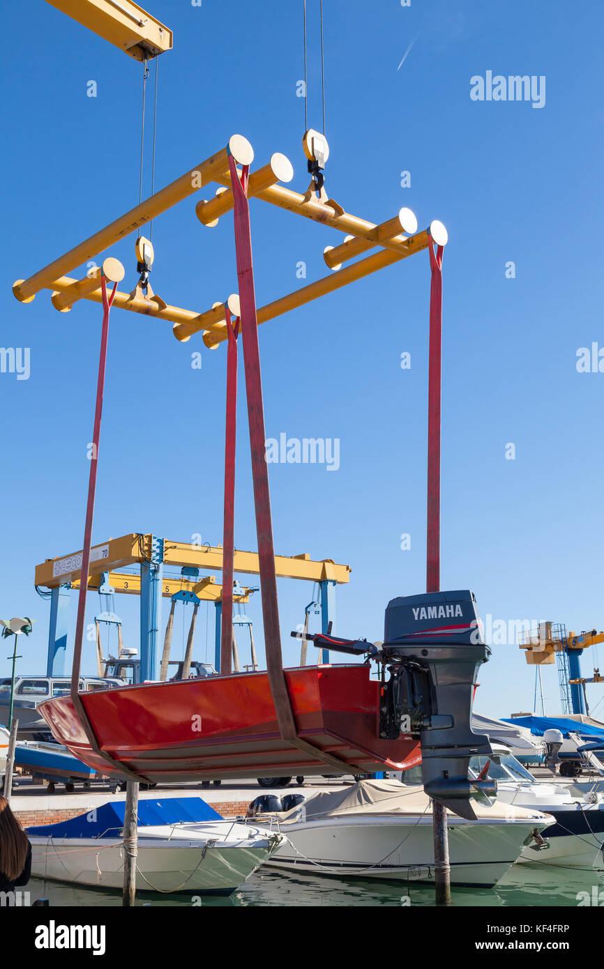 Marine lifting equipment stock photos marine lifting for Outboard motor lifting strap