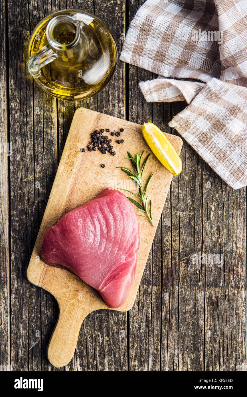 Fresh raw tuna steak on cutting board. - Stock Image