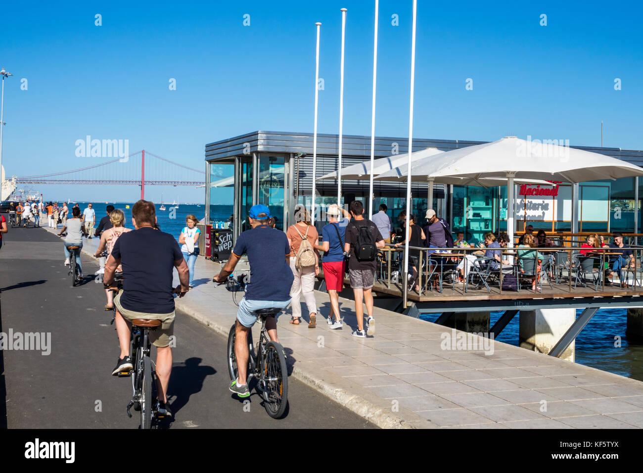 Lisbon Portugal Belem Tagus River waterfront promenade Confeitaria Nacional cafe alfresco restaurant bicycle pedestrian - Stock Image