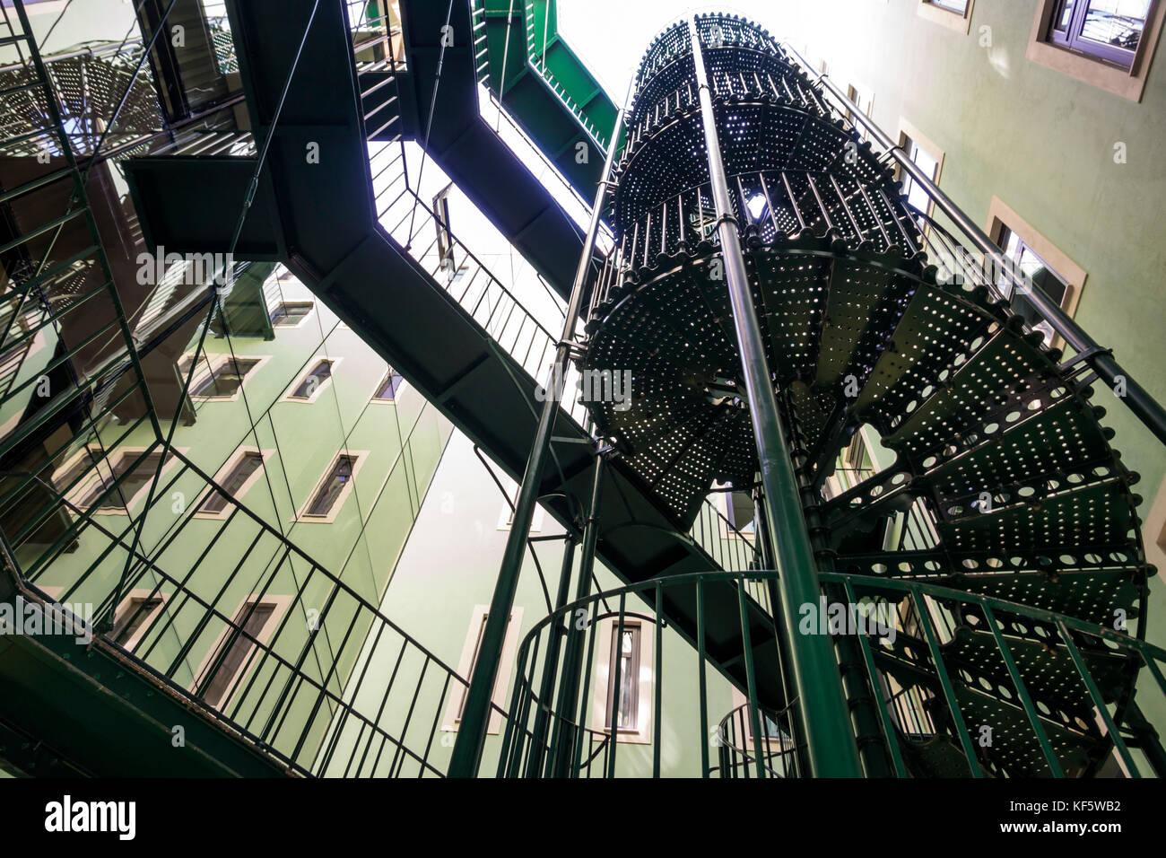 Lisbon Portugal Rua Alexandre Herculano Holiday Inn Express Liberdade hotel internal courtyard spiral staircase - Stock Image