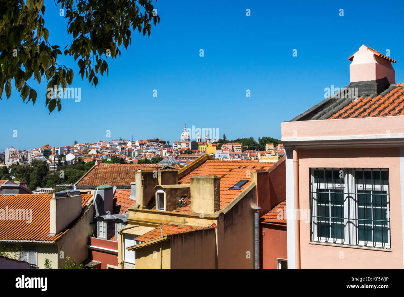 Lisbon Portugal Bairro Alto Jardim do Principe Real park garden viewpoint city skyline view rooftops red barrel - Stock Image
