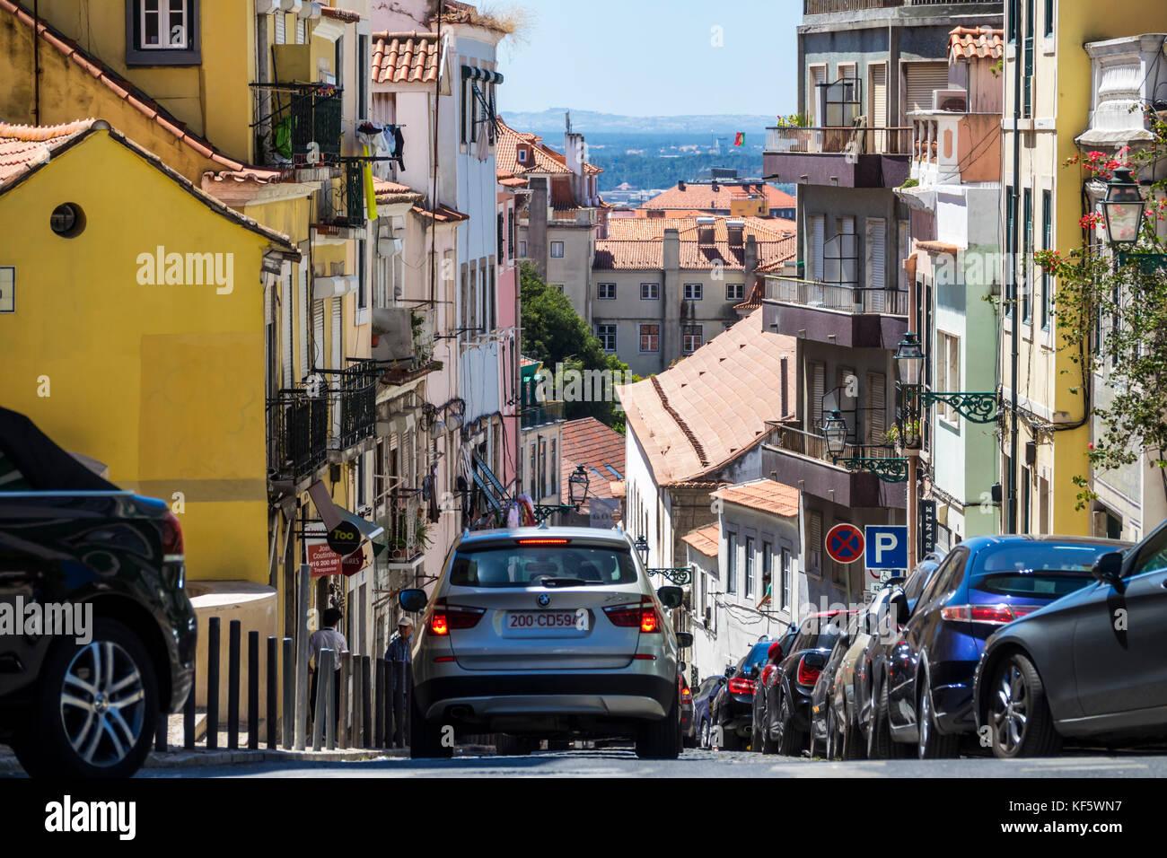 Lisbon Portugal Bairro Alto Principe Real descending street hill view buildings cars rooftops skyline city skyline - Stock Image