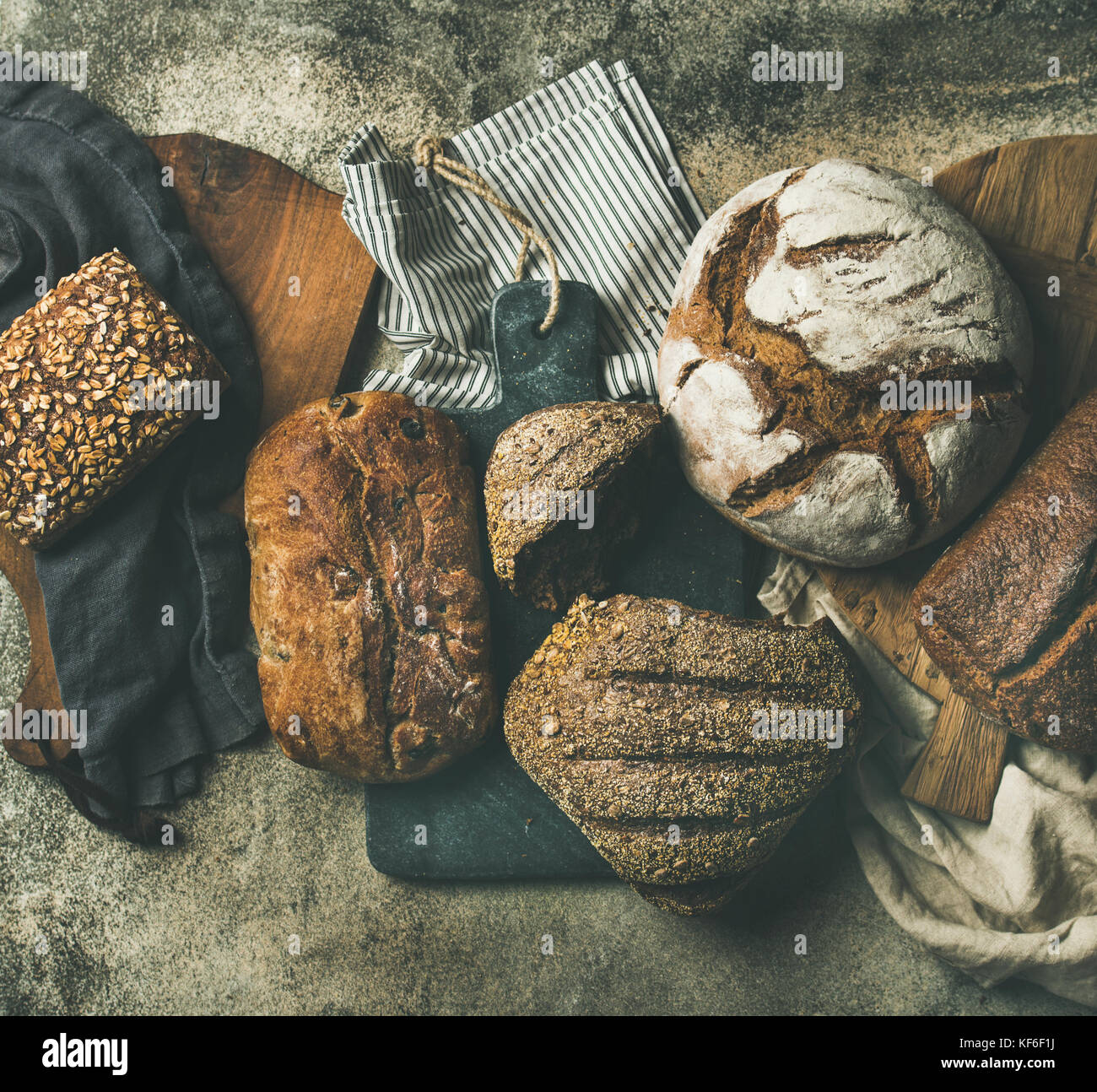 Flat-lay of various bread loaves, top view - Stock Image