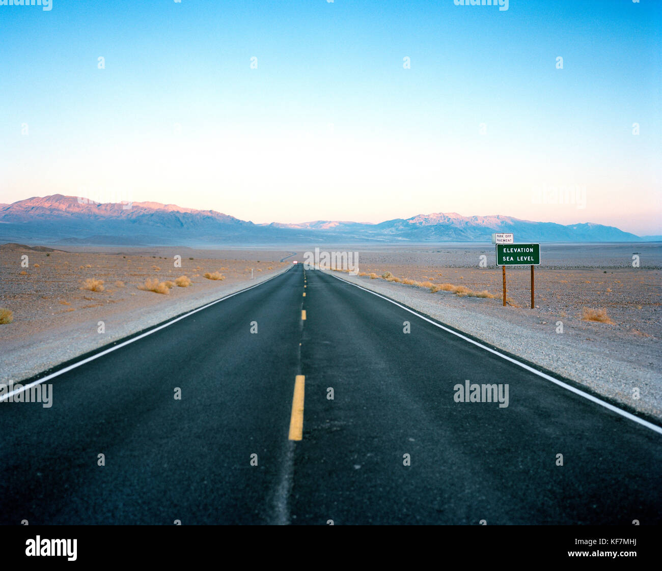 USA, California, road shot and mountains, Death Valley National Park - Stock Image