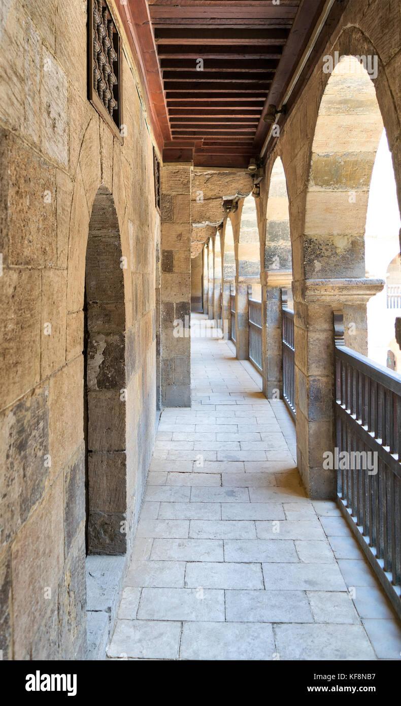 One of the arcades surrounding the courtyard of caravansary (Wikala) of Bazaraa, Medieval Cairo, Egypt - Stock Image
