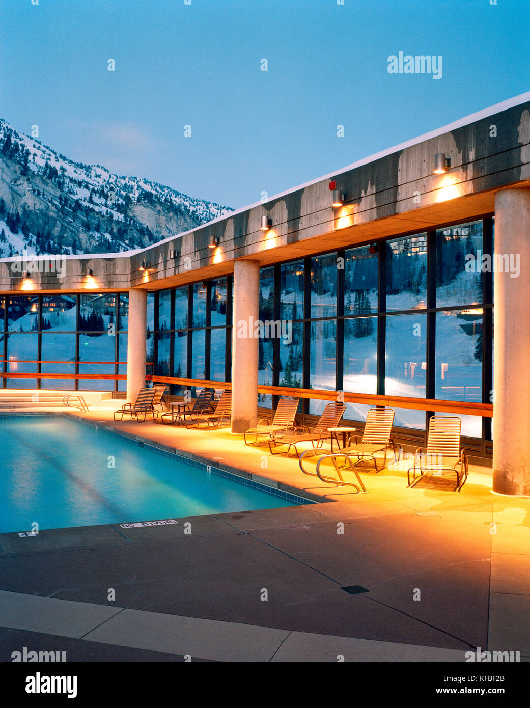USA, Utah, deck chairs by the outdoor swimming pool, The Cliff Hotel, Snowbird Ski Area - Stock Image