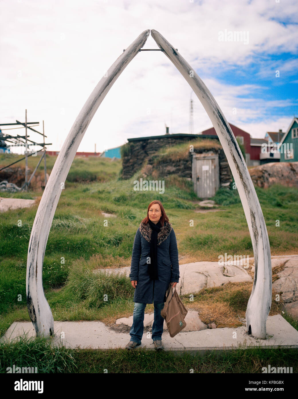 GREENLAND, Ilulissat, Knud Rasmussen Museum, portrait of young local with whale tusks - Stock Image