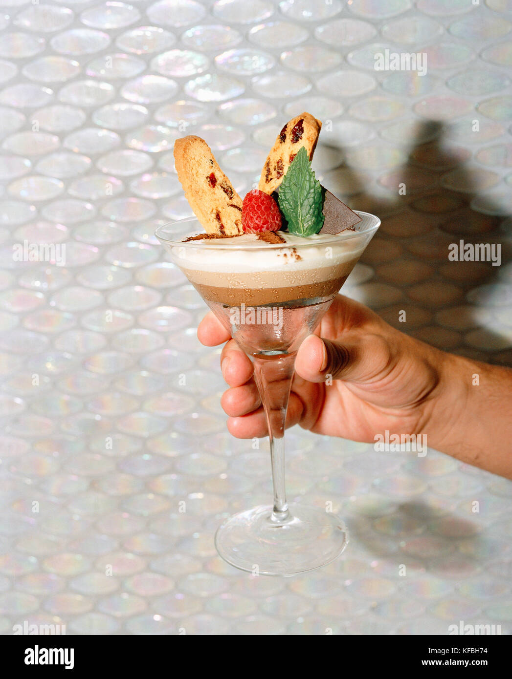 MEXICO, Punta Mita, human hand holding chocolate mousse dessert at cafe des artistes - Stock Image