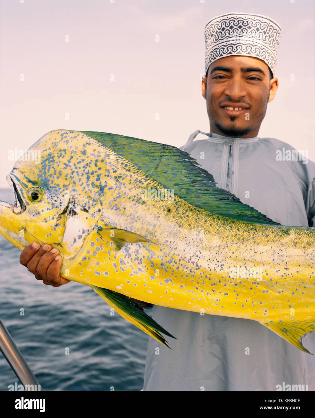 OMAN, Muscat, man holding mahi mahi fish, portrait - Stock Image
