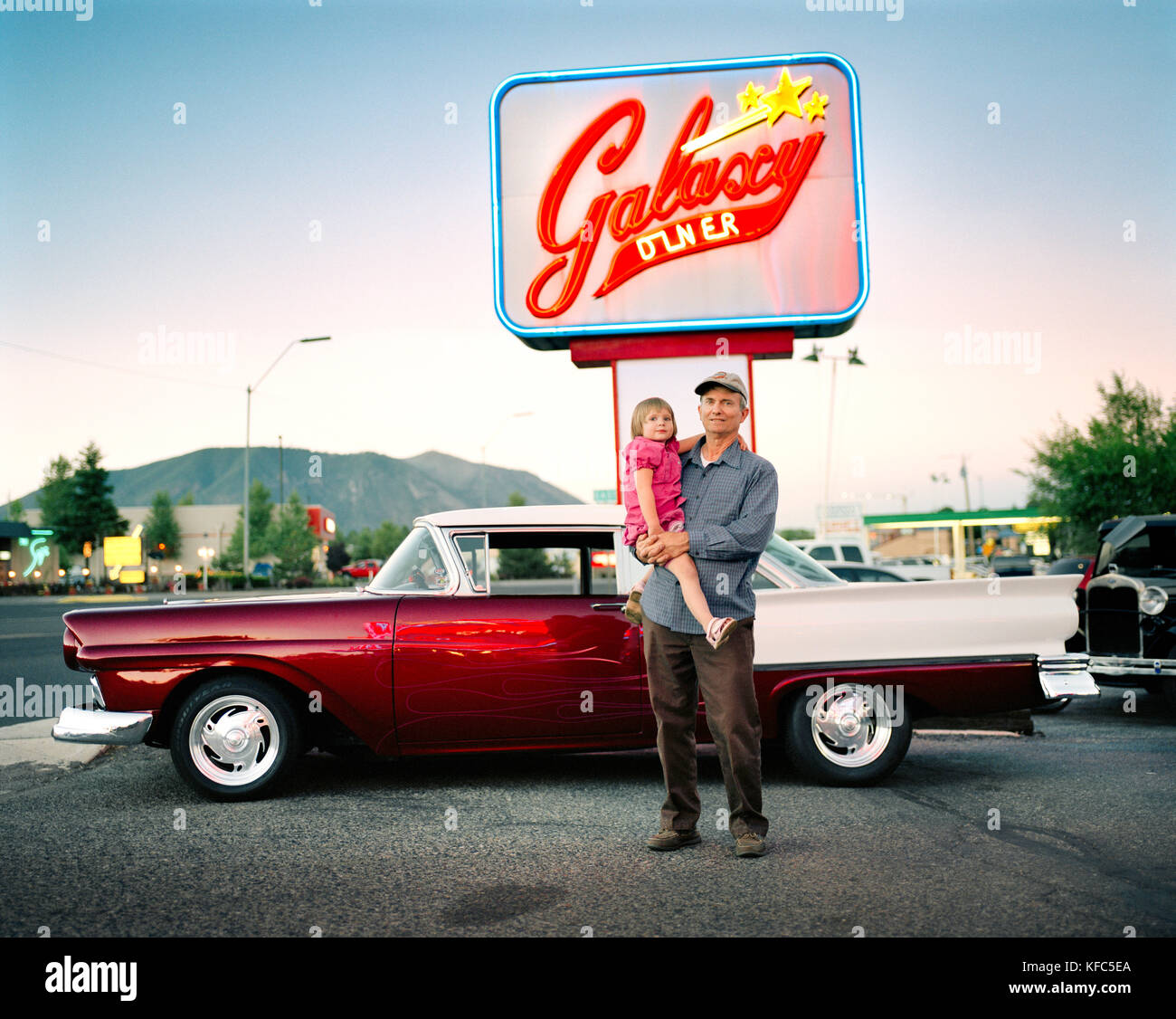USA, Arizona, grandfather and granddaughter by ford fairlane, Galaxy Diner, Flagstaff - Stock Image