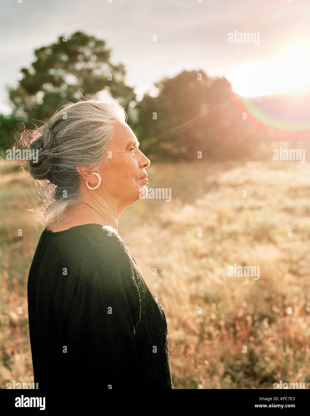 USA, New Mexico, beautiful Native American woman at sunset, Valley of the Wild Roses - Stock Image