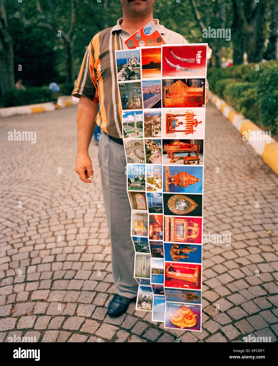 TURKEY, Istanbul, man selling various postcard at street - Stock Image