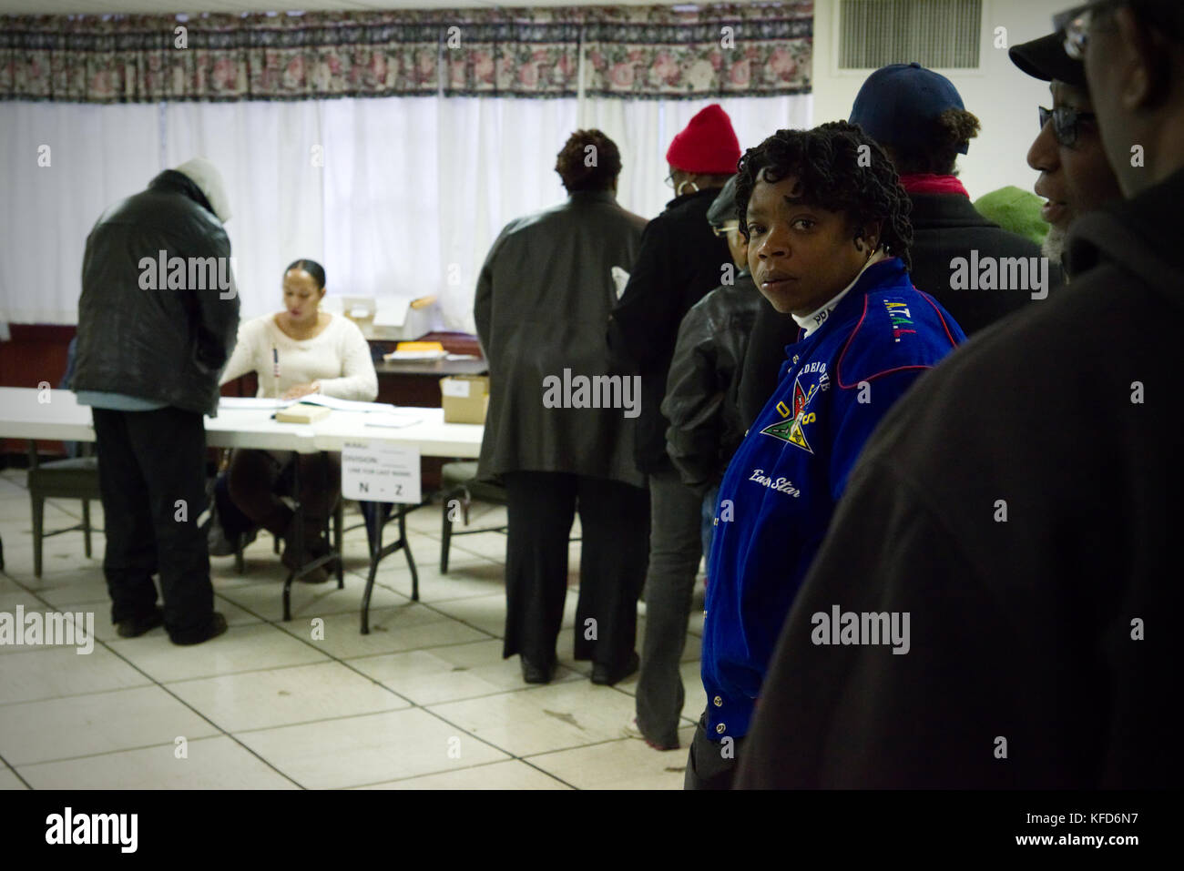 Voters wait in line to cast the ballot at a poling station in Philadelphia, PA, on Election Day. - Stock Image