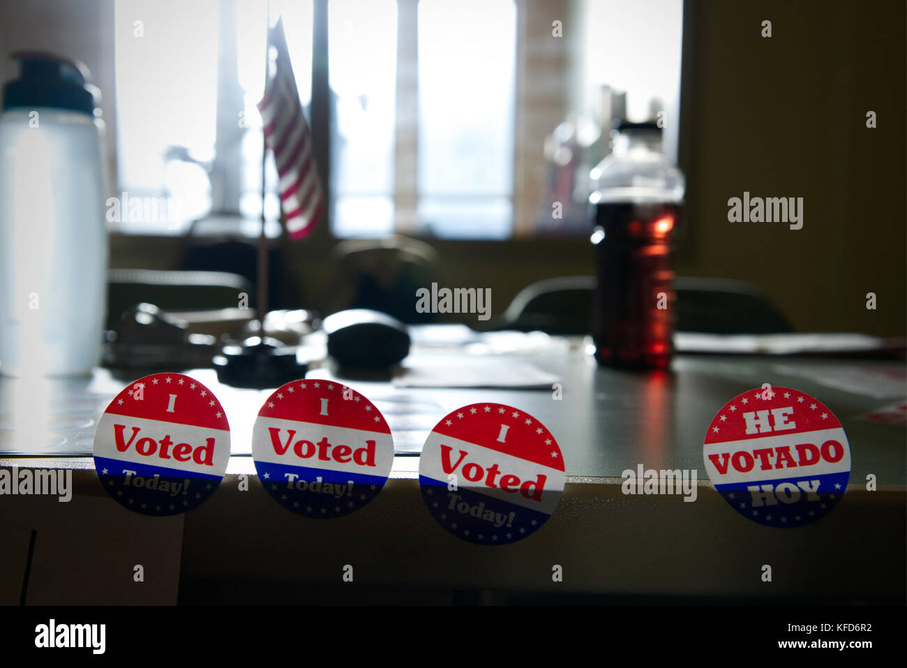 Stickers are offered to voters at a polling station, on Election Day. - Stock Image