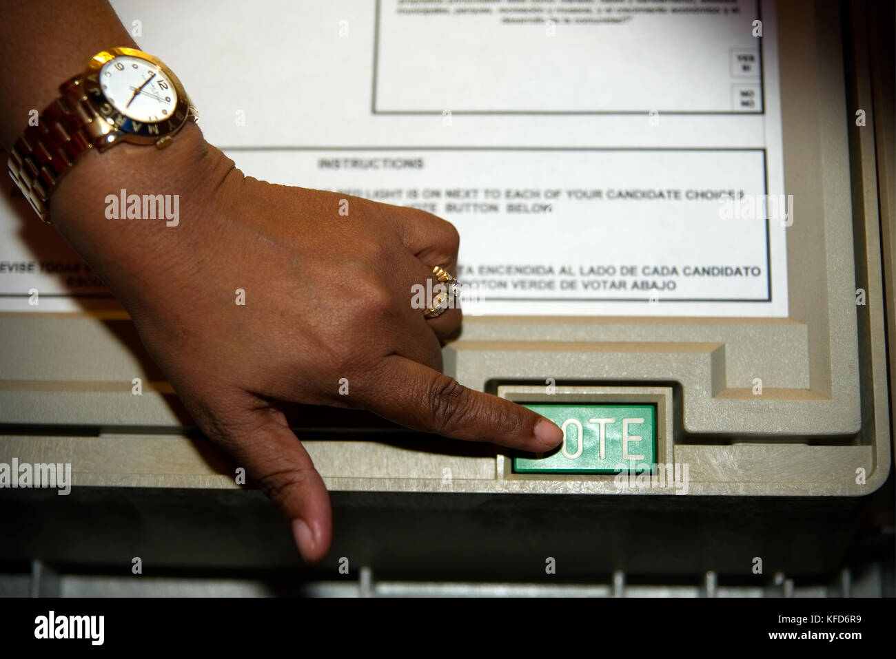Voter casts the ballot on an electronic voting machine at a polling station on Election Day, in Philadelphia, PA. - Stock Image