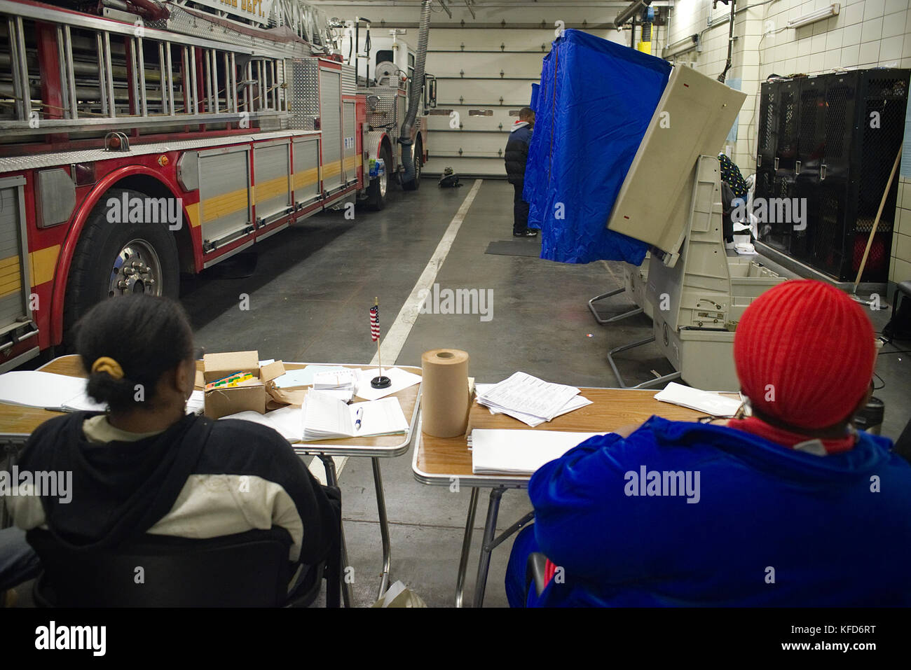 Electronic voting machines stand next to a fire truck of the Philadelphia Fire Dept., on Election Day at a Philadelphia, - Stock Image