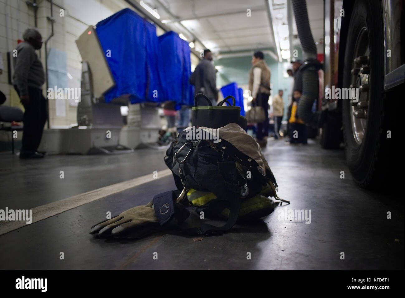 Firefighter gear sits on the ground next to a fire truck on Election Day at a Philadelphia, PA poling station. - Stock Image