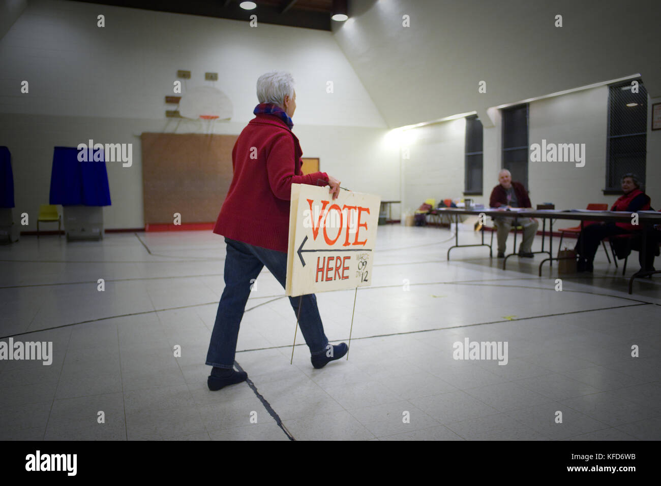 Poll workers wait for voters at a Philadelphia, PA poling station on Election Day. - Stock Image