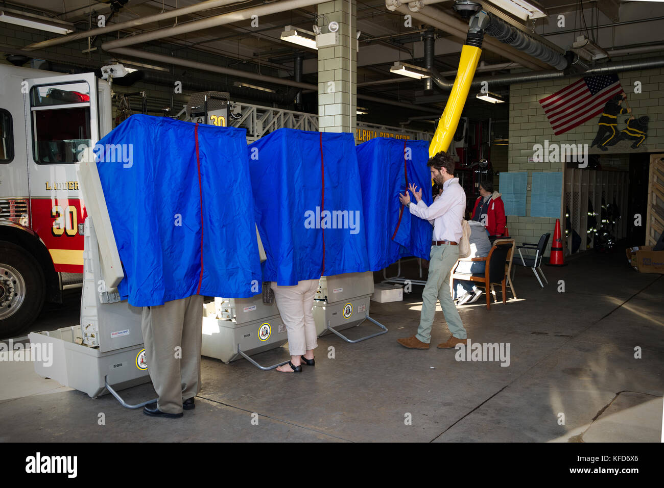 On Election Day, American citizens cast the ballot at a polling station located inside a Philadelphia, PA fire station. - Stock Image